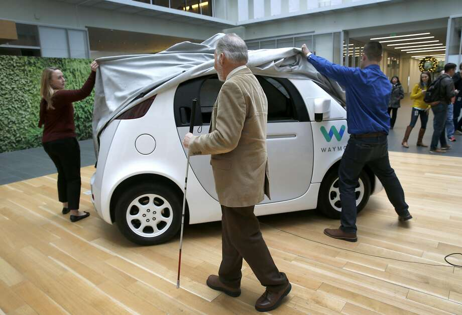Steve Mahan, the blind first user of the Waymo, waits for employees to unveil the driverless car at Google's offices in San Francisco, Calif. on Tuesday, Dec. 13, 2016. Photo: Paul Chinn, The Chronicle