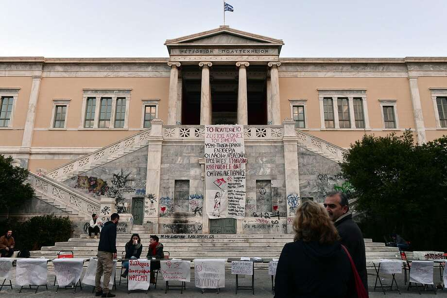 A banner denouncing the European Union and the International Monetary Fund hung at the Athens polytechnic school last month. Photo: LOUISA GOULIAMAKI, AFP/Getty Images