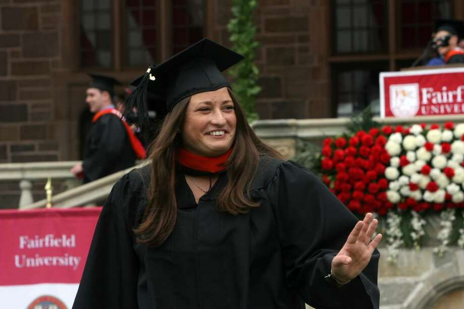 Courtney Jago, of MA, receives her diploma at Fairfield University's commencement ceremony on Sunday, May 23, 2010. Photo: B.K. Angeletti / Connecticut Post