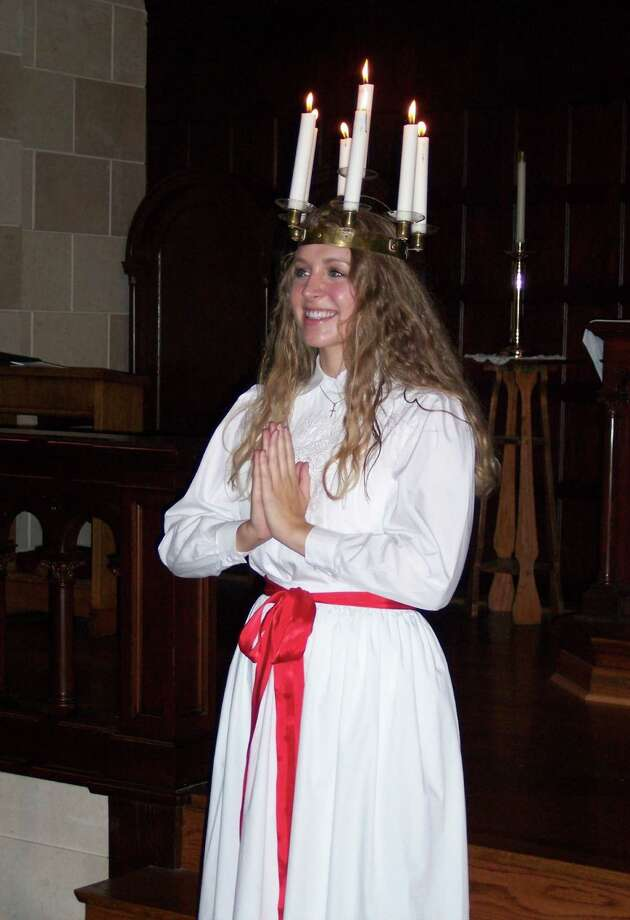 """Kingwood graduate Lisa Swank represents warmth and light as """"Lucia"""" in this year's Swedish Club of Houston celebration. Photo: Courtesy Photo"""