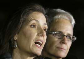 Oakland Mayor Libby Schaaf, left, speaks next to Oakland Police Dept. spokesperson Johnna Watson at a news conference near the site of a warehouse fire in Oakland, Calif., Tuesday, Dec. 6, 2016. The fire erupted Friday, Dec. 2, killing dozens. (AP Photo/Jeff Chiu)