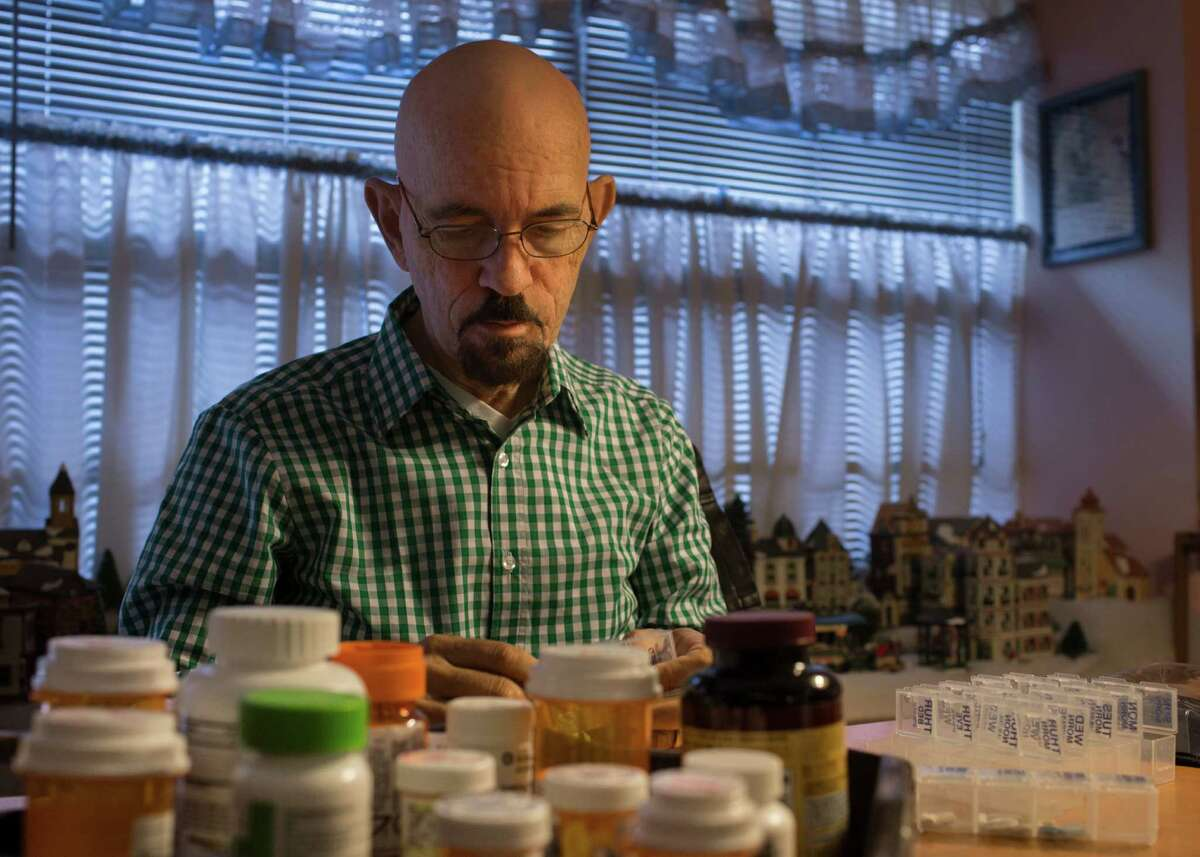 Randy Smith, 65, fills up his pill organizer at his home in Houston, Friday, Dec. 2, 2016. Smith who received a liver during a transplant that took place in August, takes about 16 pills a day. Smith is one of eight patients nationally who received a liver transplant as part of clinical trial which involved taking a marginal liver from a donor and running it through a new machine that purifies it of contaminants before the transplant operation.