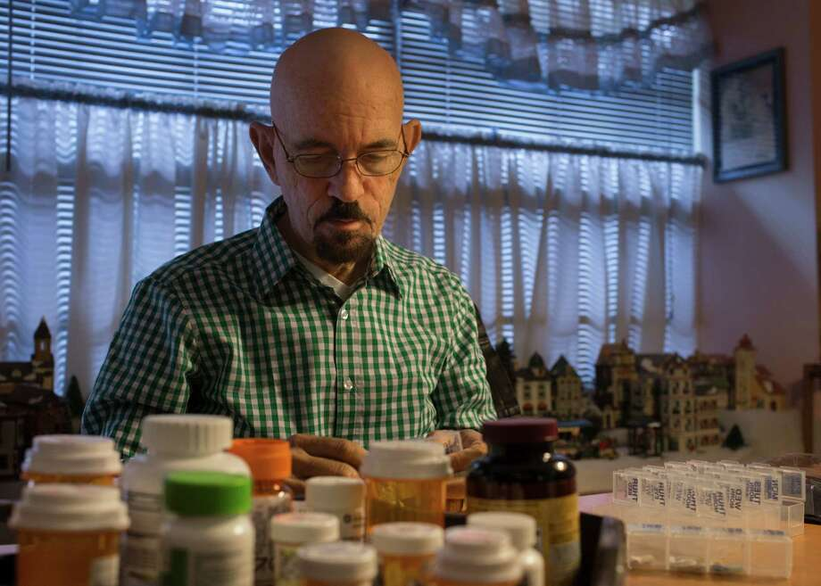 Randy Smith, 65, fills up his pill organizer at his home in Houston, Friday, Dec. 2, 2016. Smith who received a liver during a transplant that took place in August, takes about 16 pills a day. Smith is one of eight patients nationally who received a liver transplant as part of clinical trial which involved taking a marginal liver from a donor and running it through a new machine that purifies it of contaminants before the transplant operation. Photo: Marie D. De Jesus, Houston Chronicle / © 2016 Houston Chronicle