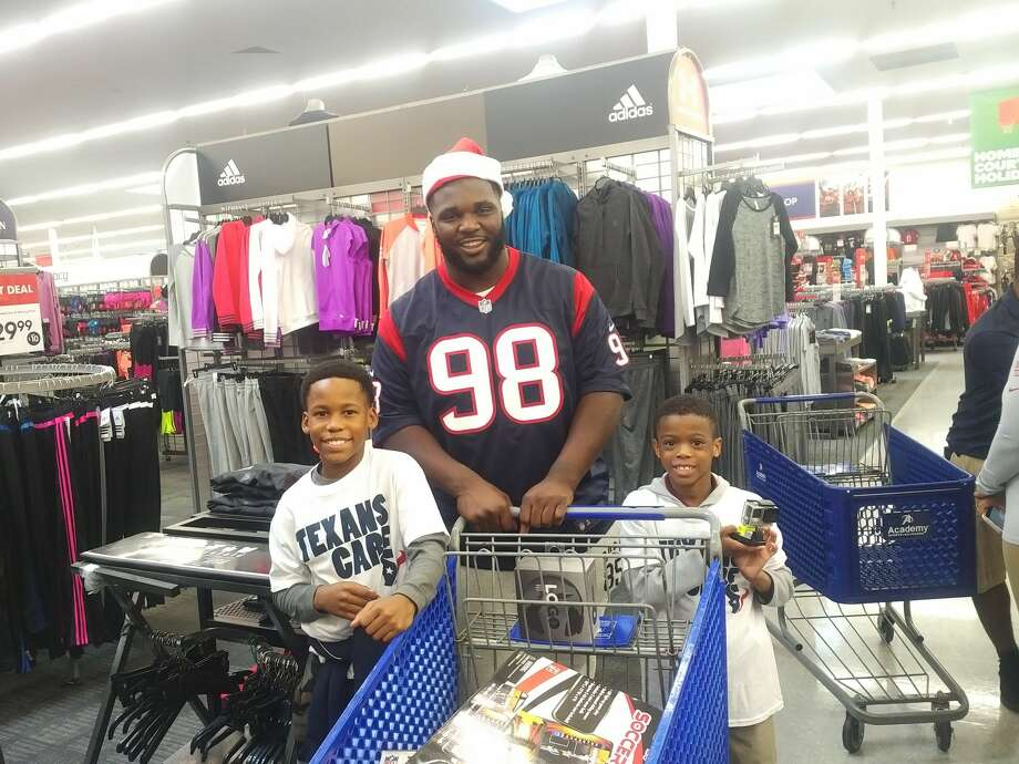 Texans rookie D.J. Reader helped children from the Houston Texans YMCA and Boys & Girls Clubs pick out holiday presents during a shopping spree. Photo: Aaron Wilson
