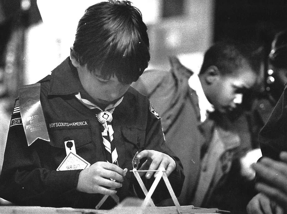Benoit Lamairesse, 7 and member of Cub Scout Pack 3, builds a Popsicle stick and kebab skewer bridge on Feb. 27, 1993, at a 40-booth event showcasing the activities of the Greenwich Council of the Boy Scouts of America. Photo: Paul DesMarais /
