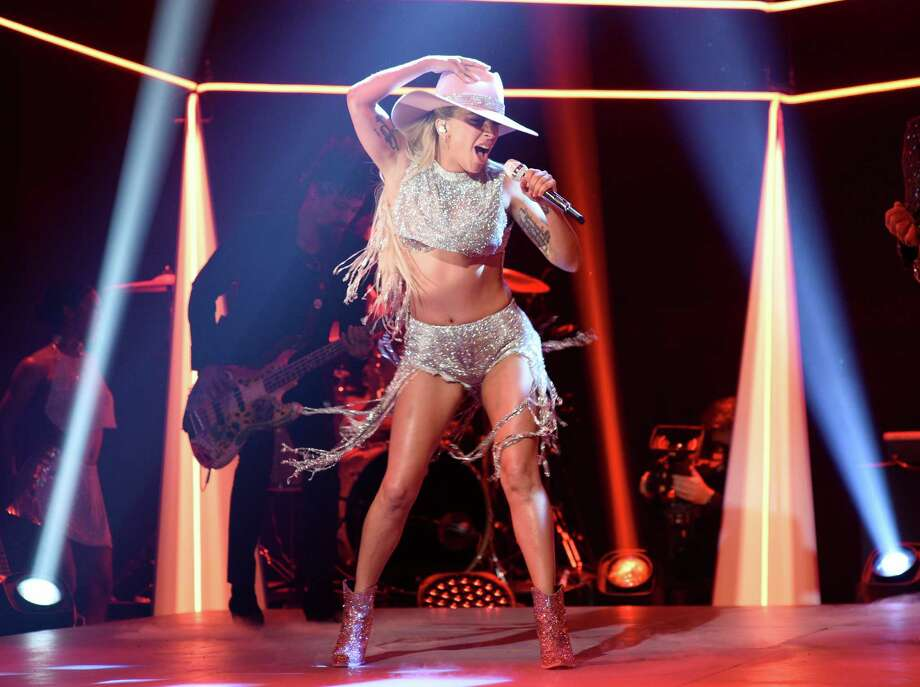 """This Oct. 22, 2016 photo released by NBC shows Lady Gaga performing on """"Saturday Night Live,"""" in New York. Lady Gaga released her latest album, """"Joanne,"""" on Friday. (Will Heath/NBC via AP) Photo: Will Heath, HONS / 2016 NBCUniversal Media, LLC"""