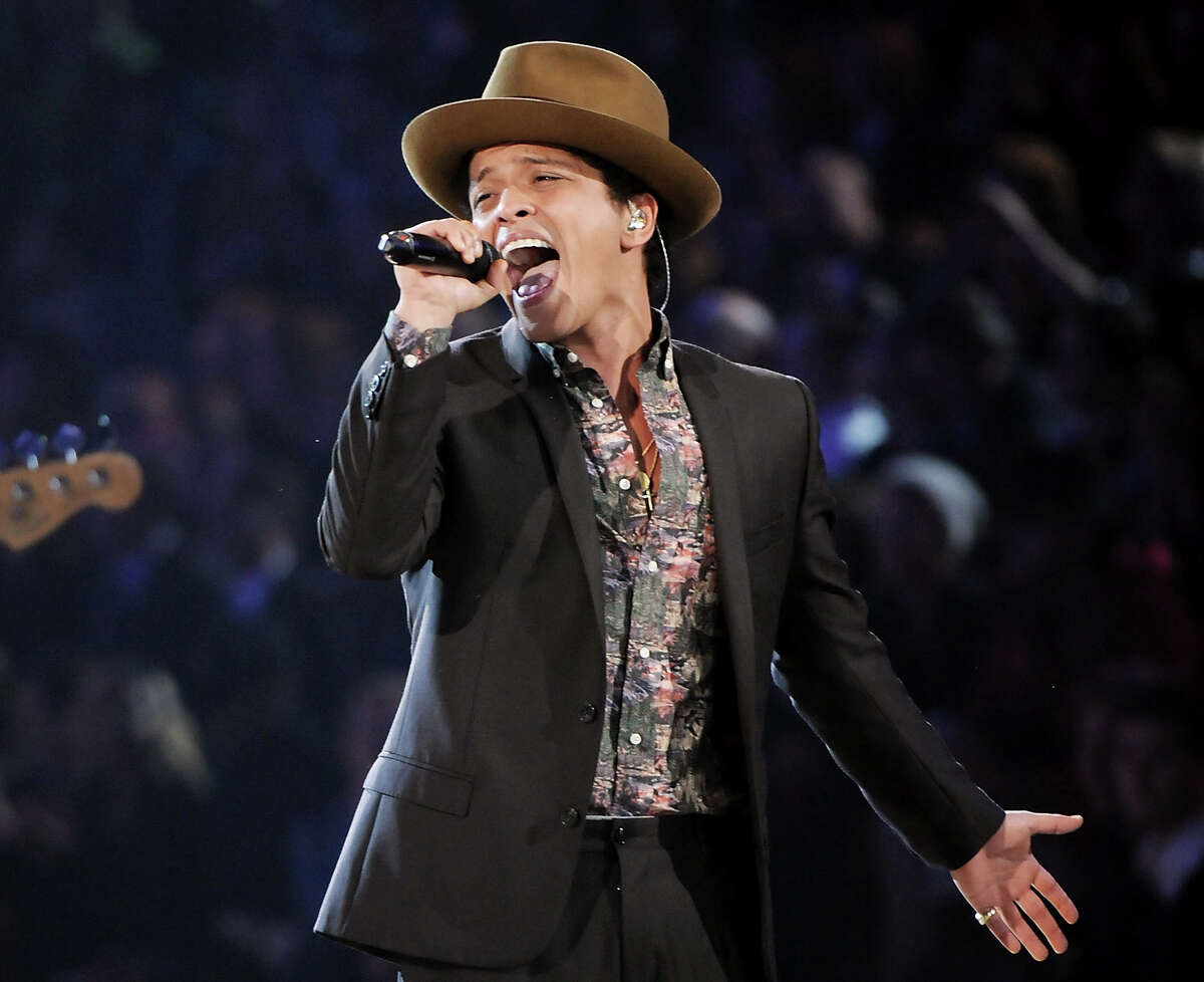 In this Nov. 7, 2012 file photo, Bruno Mars performs during the 2012 Victoria's Secret Fashion Show in New York. Las Vegas is set to ring in 2014 with big-name concerts, celebrity-hosted parties and an eight-minute rooftop fireworks display billed as the nation's largest. Mars is christening the Cosmopolitan's new Chelsea Ballroom. The show will be broadcast live on the casino's 65-foot (20-meter) marquee to ice skaters at a rooftop rink and partyers on the Strip below. (Photo by Evan Agostini/Invision/AP)