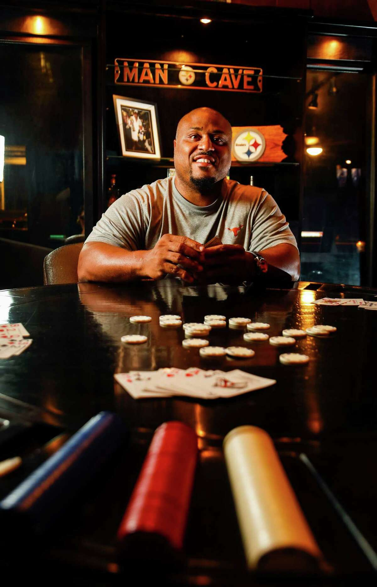 Two-time Super Bowl champ Casey Hampton, who played for the Pittsburgh Steelers, enjoys card games and dominoes in his man cave. Though spare on sports memorabilia, his décor includes an ESPN cover featuring his team, right.