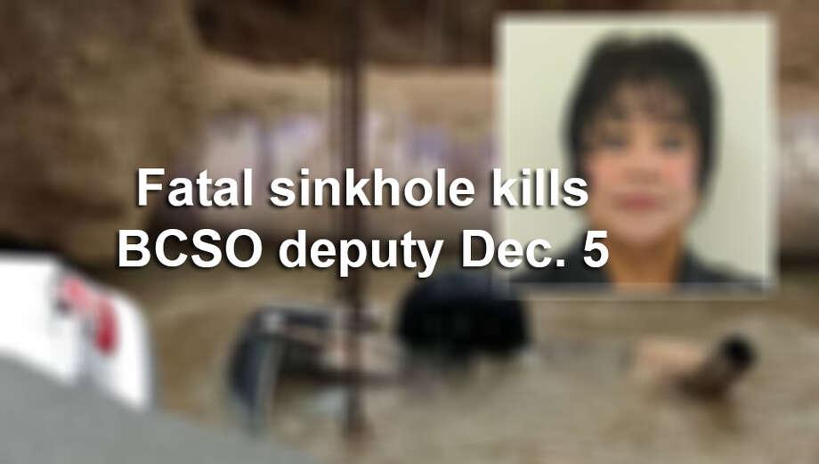 A sinkhole swallowed two vehicles Dec. 5 killing a Bexar County Sheriff's Office deputy. Photo: Mysa