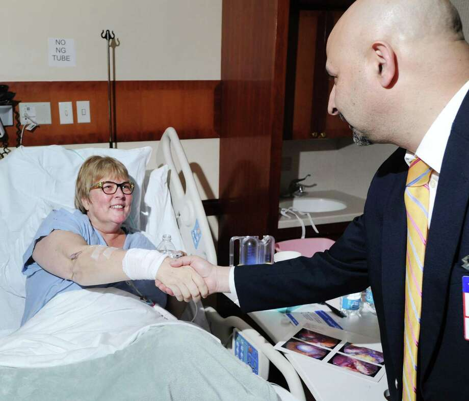 Dr. Ashutosh Kaul, right, shakes hands with his bariatric surgery patient, Amy Anderson, 58, of Bronxville, N.Y., in Anderson's room at Greenwich Hospital in Greenwich, Conn., Tuesday afternoon, Dec. 13, 2016. Photo: Bob Luckey Jr. / Hearst Connecticut Media / Greenwich Time