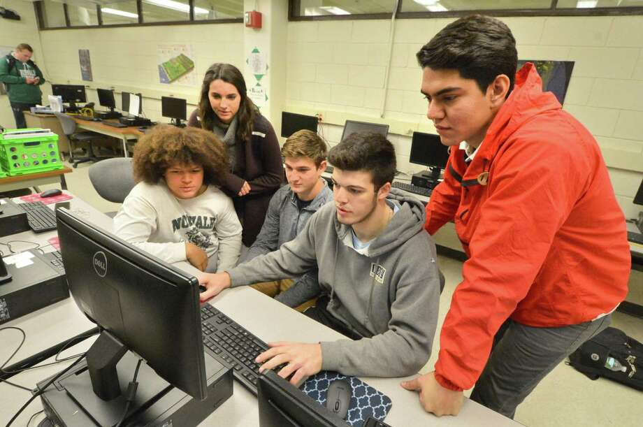 Students in Mary Beth Morrison's Civil Engineering and Architecture class, James Roberts, Emma Guilbault, Alex Morrisey, Kevin Remson and Luis Vega work in the computer lab while seeking funds to help their teacher purchase a 3-D printer. Working with the eNable Community Foundation's Build a Hand program, the team will use the 3-D printer to make the parts of robotic hands at Norwalk High School. Photo: Alex Von Kleydorff / Hearst Connecticut Media / Connecticut Post