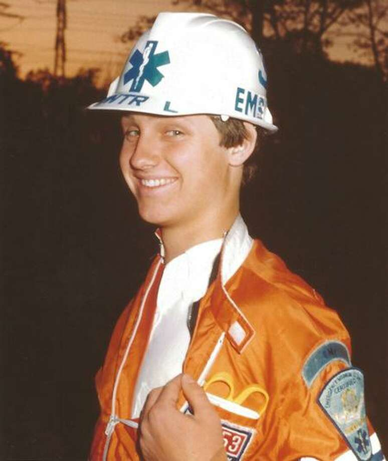 High School 9-1-1 Director Tim Warren during his days as a Postie, where he volunteered from 1982 through 1985. Photo: Darien News/Contributed / Contributed Photo / Darien News