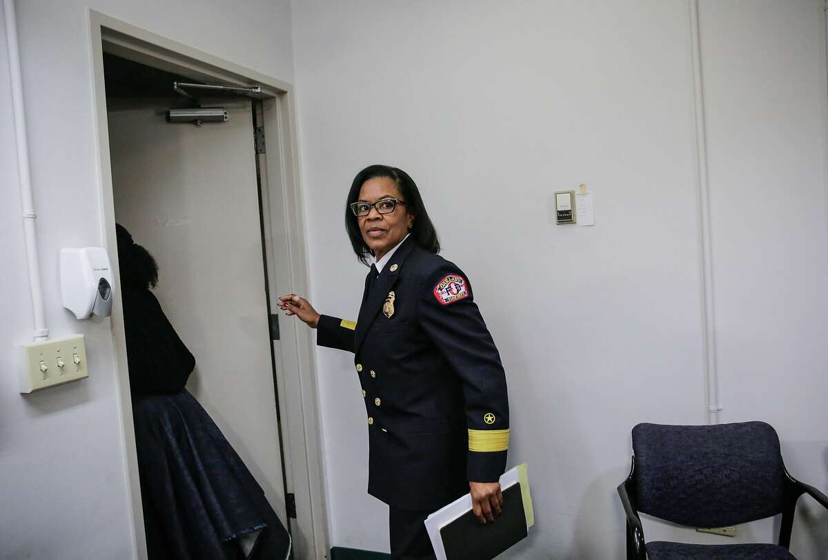 Oakland Fire Chief Teresa Deloach Reed leaves a press conference which gave an update on the status of the investigation of the fire that killed 36 at the Ghost Ship in Oakland, Calif., on Tuesday, Dec. 13, 2016.