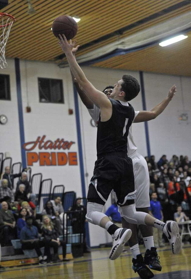 Photographs from the boys first round Connecticut Class LL basketball game between Staples and Danbury high schools, on Tuesday night, March 8, 2016, at Danbury High School, Danbury, Conn. Photo: H. John Voorhees III / Hearst Connecticut Media / The News-Times