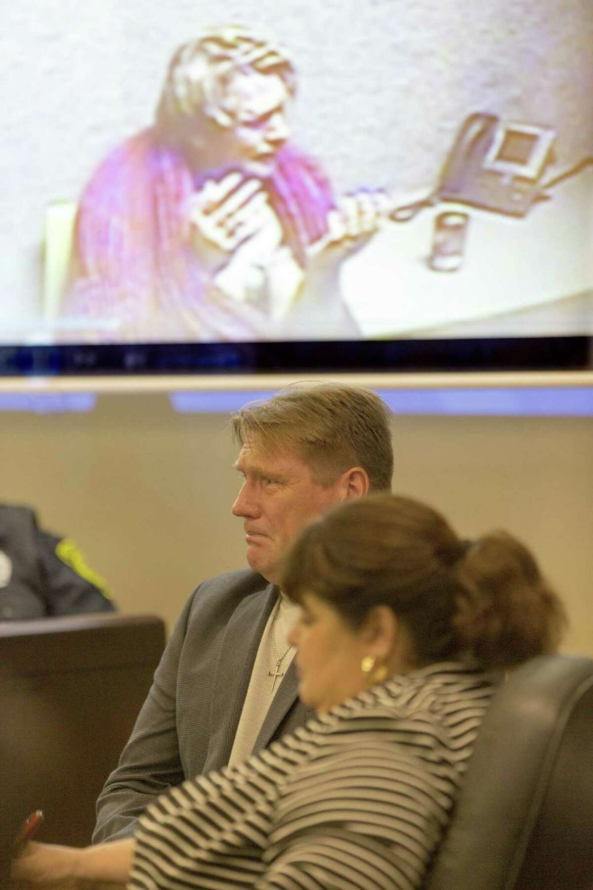 Interrogation room video is projected Tuesday, Dec, 13, 2016 above defendant Lars Itzo's head during his murder trial for the shooting death of his wife Debora Kelly. Itzo admitted to investigators during questioning he shot his wife but he said he thought she was an intruder