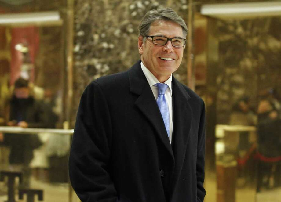Former Texas Gov. Rick Perry smiles as he leaves Trump Tower  in New York. Photo: Kathy Willens / Associated Press / Copyright 2016 The Associated Press. All rights reserved.