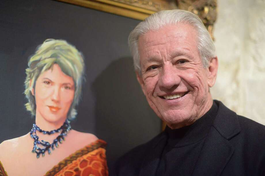 Lionel Sosa, Hispanic advertising pioneer and artist, stands by his painting of his wife, Kathy, in his studio in 2015. Photo: Billy Calzada /San Antonio Express-News / © 2015 San Antonio Express-News