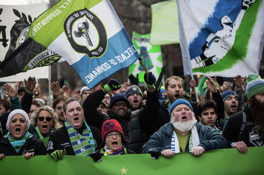 Sounders fans march from Westlake Park to Seattle Center. Photo: GRANT HINDSLEY, SEATTLEPI.COM / SEATTLEPI.COM