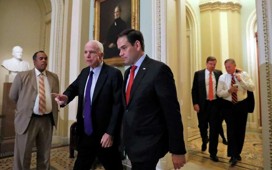FILE - In this Nov. 16, 2016 file photo, Sen. John McCain, R-Ariz., left, and Sen. Marco Rubio, R-Fla., followed by Sen. Mark Warner, D-Va., and Sen. Richard Burr, R-N.C., walk on Capitol Hill in Washington. Donald Trump is inviting a clash in a narrowly divided Senate by selecting Rex Tillerson for secretary of State despite well-publicized concerns from several GOP senators over his ties to Russia. (AP Photo/Alex Brandon, File) Photo: Alex Brandon, STF / Copyright 2016 The Associated Press. All rights reserved.