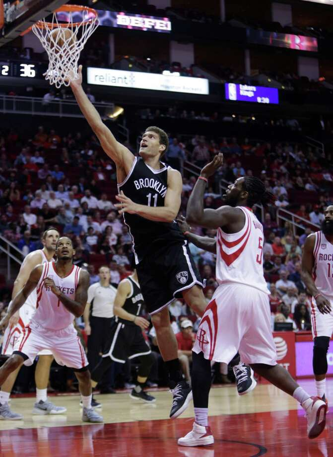 Nets center Brook Lopez, center, split the Rockets' defense for a team-high 26 points Monday. The Rockets yielded a season-high 68 points in the paint. Photo: Mark Mulligan, Staff / © 2016 Houston Chronicle