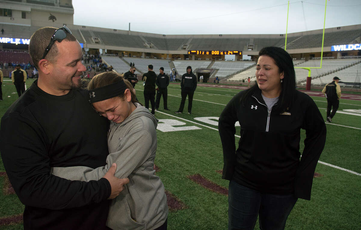 Richmond Foster Head Football Coach Shaun McDowell, from left, consoles his daughter Ella, 10, a 5th grader at Frost Elem., while his wife Lisa, waits for a hug after the Falcon's 31-24 loss to Temple in their Class 5A Division I state semifinal matchup at Bobcat Stadium on the campus of Texas State University in San Marcos on Saturday, Dec. 10, 2016. (Photo by Jerry Baker/Freelance)