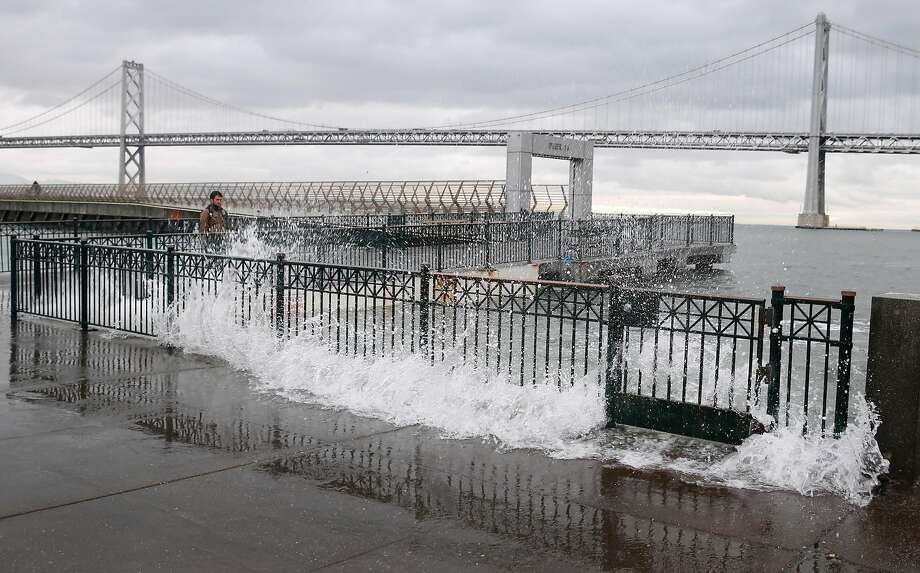 Water from the bay crashes onto the sidewalk at Pier 14 along the Embarcadero at high tide in San Francisco, Calif. on Tuesday, Nov. 24, 2015. King tide conditions are causing higher than usual water levels. Photo: Paul Chinn / The Chronicle