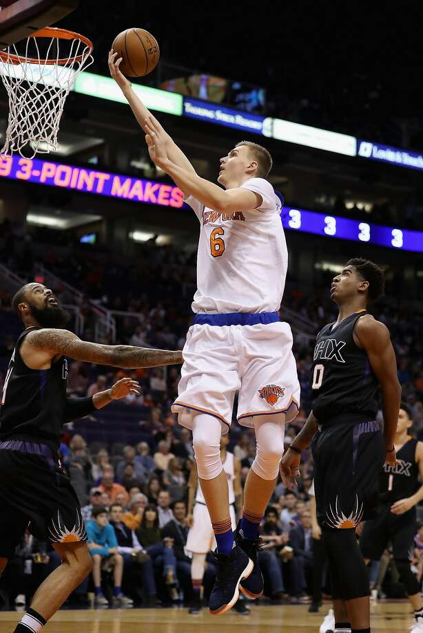 The Knicks' 7-foot-3 Kristaps Porzingis lays up a shot against the Phoenix Suns. He went 4-for-4 from beyond the arc. Photo: Christian Petersen, Getty Images
