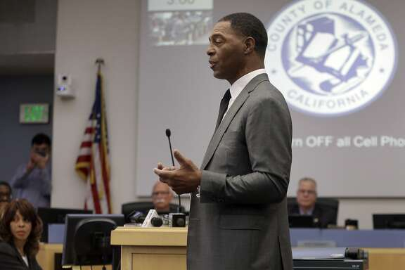 Former professional football player Marcus Allen gestures while speaking before a meeting of the the Alameda County Board of Supervisors on Tuesday, Dec. 13, 2016, in Oakland, Calif. The Alameda County Board of Supervisors has approved a $1.3 billion stadium project that might keep the Oakland Raiders in Oakland. (AP Photo/Ben Margot)