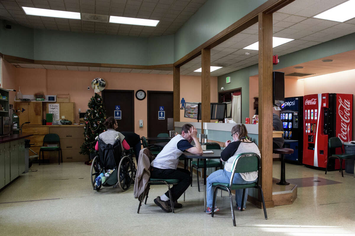Clients hang out in the cafe, a central social area at Rainier School, on Nov. 29, 2016.