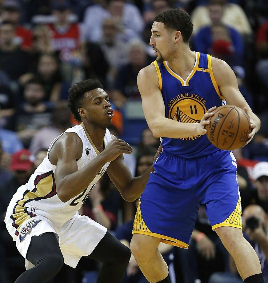 Golden State Warriors guard Klay Thompson (11) is guarded by New Orleans Pelicans guard Buddy Hield (24) in the first half of an NBA basketball game in New Orleans, Tuesday, Dec. 13, 2016. (AP Photo/Tyler Kaufman) Photo: Tyler Kaufman, Associated Press
