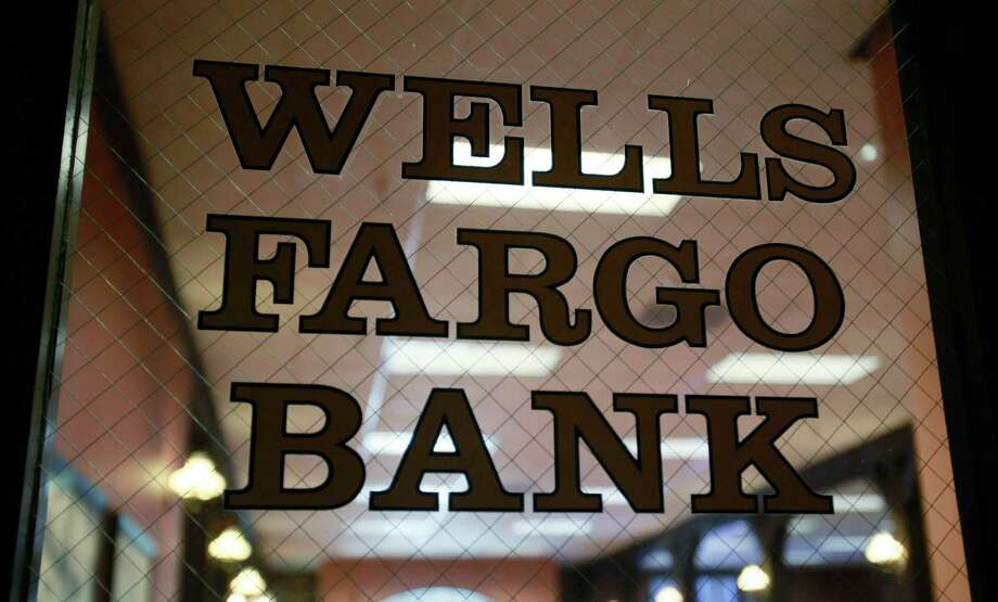 Federal regulators on Tuesday slapped new restrictions on Wells Fargo. Photo: Paul Sakuma, STF / AP2010