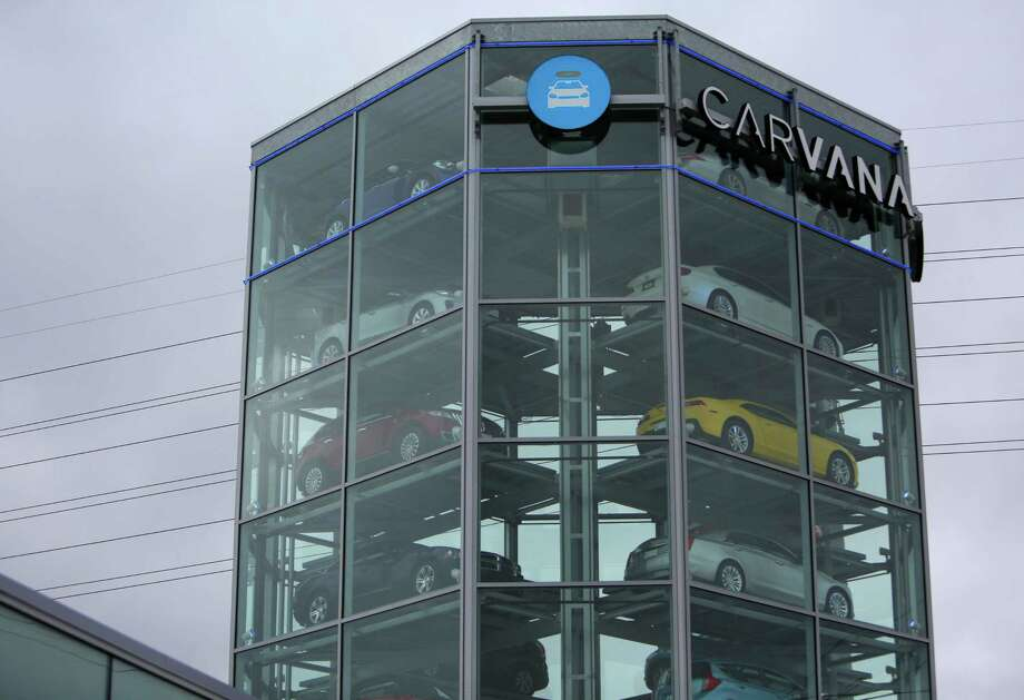 "The  eight-story ""coin-operated car vending machine"" built by Carvana, towers over I-10. Photo: Mark Mulligan, Staff / © 2016 Houston Chronicle"