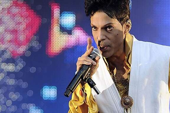 "(FILES) This file photo taken on June 30, 2011 US singer and musician Prince performing on stage at the Stade de France in Saint-Denis, outside Paris.  Prince, who scrapped a hotly anticipated ""Piano and Microphone"" tour of Europe, has rescheduled his shows -- for Australia and New Zealand. The pop star, known for his love of surprises, posted a flier Thursday on Twitter that read simply: ""Piano and a Microphone - Prince - Australia and New Zealand - February 2016."" Prince had earlier announced a tour in November and December of Europe that would have been the first in the 57-year-old pop legend's career in which he solely sings and plays piano.  / AFP / BERTRAND GUAYBERTRAND GUAY/AFP/Getty Images"