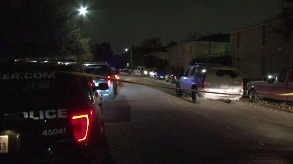 Police investigate after a car burglar's random gunshot killed a woman in southeast Houston late Tuesday, Dec. 13, 2016. (Metro Video)