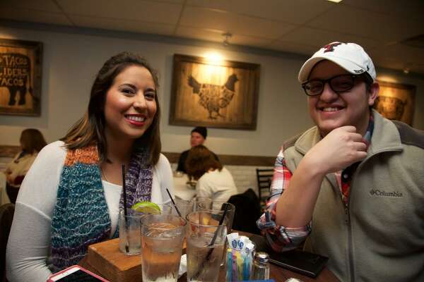 Genevieve Garcia and John Pena hang out at Sangria on the Burg.