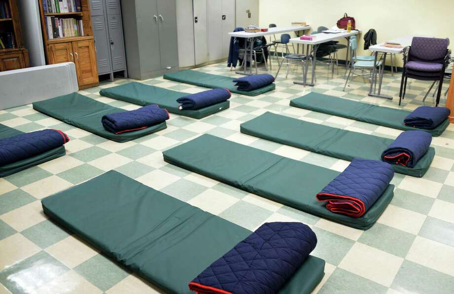 A classroom at Capital City Rescue Mission is converted to temporary sleeping quarters for Code Blue Friday Nov. 28, 2014, in Albany, NY. (John Carl D'Annibale / Times Union) Photo: John Carl D'Annibale / 00029666A
