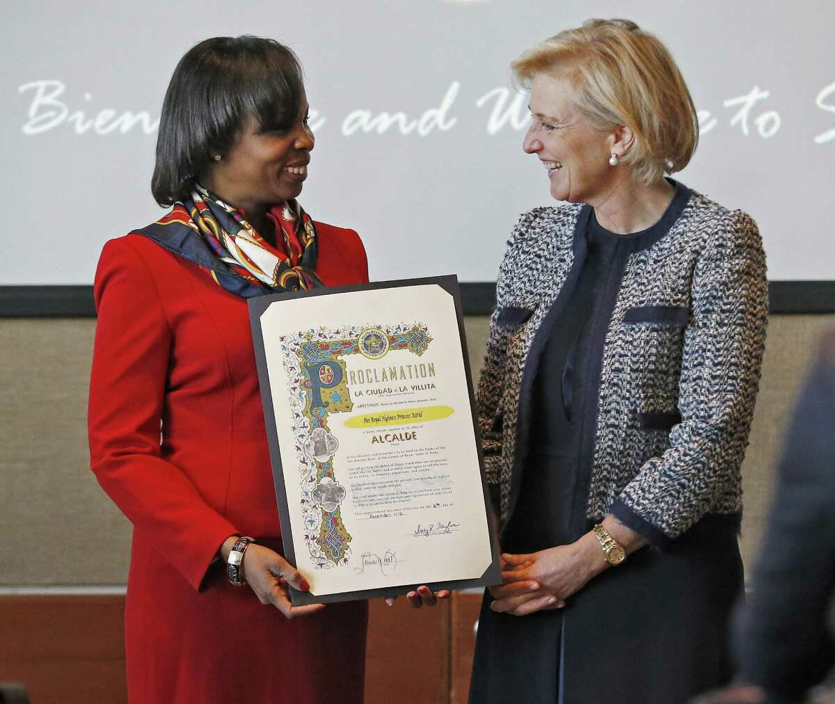 Princess Astrid of Belgium (right) is presented with a city proclamation by San Antonio Mayor Ivy Taylor before a business meeting at the International Center building where the city and Belgian business delegates gathered on Tuesday, Dec. 6, 2016. The Belgian delegation is traveling the state of Texas to meet with officials regarding trade and investment. Mayor Taylor along with other city and county officials will put their best foot forward to give the Belgians a positive impression of San Antonio.