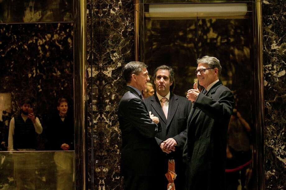 National security adviser pick Michael Flynn (from left), lawyer Michael Cohen and Rick Perry talk at the Trump Tower. Photo: Sam Hodgson / New York Times / NYTNS
