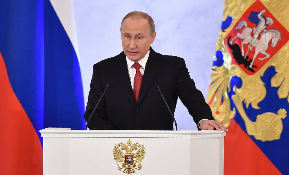"""(FILES) This file photo taken on December 1, 2016 shows Russian President Vladimir Putin addressing the Federal Assembly of both houses of parliament at the Kremlin in Moscow. Vladimir Putin was the world's most powerful person for a fourth straight year in 2016, with US president-elect Donald Trump in second place, Forbes magazine said December 14, 2016 in its annual rankings. """"Russia's president has exerted his country's influence in nearly every corner of the globe,"""" the US business magazine wrote. """"From the motherland to Syria to the US presidential elections, Putin continues to get what he wants.""""   / AFP PHOTO / Natalia KOLESNIKOVANATALIA KOLESNIKOVA/AFP/Getty Images Photo: NATALIA KOLESNIKOVA, AFP/Getty Images"""