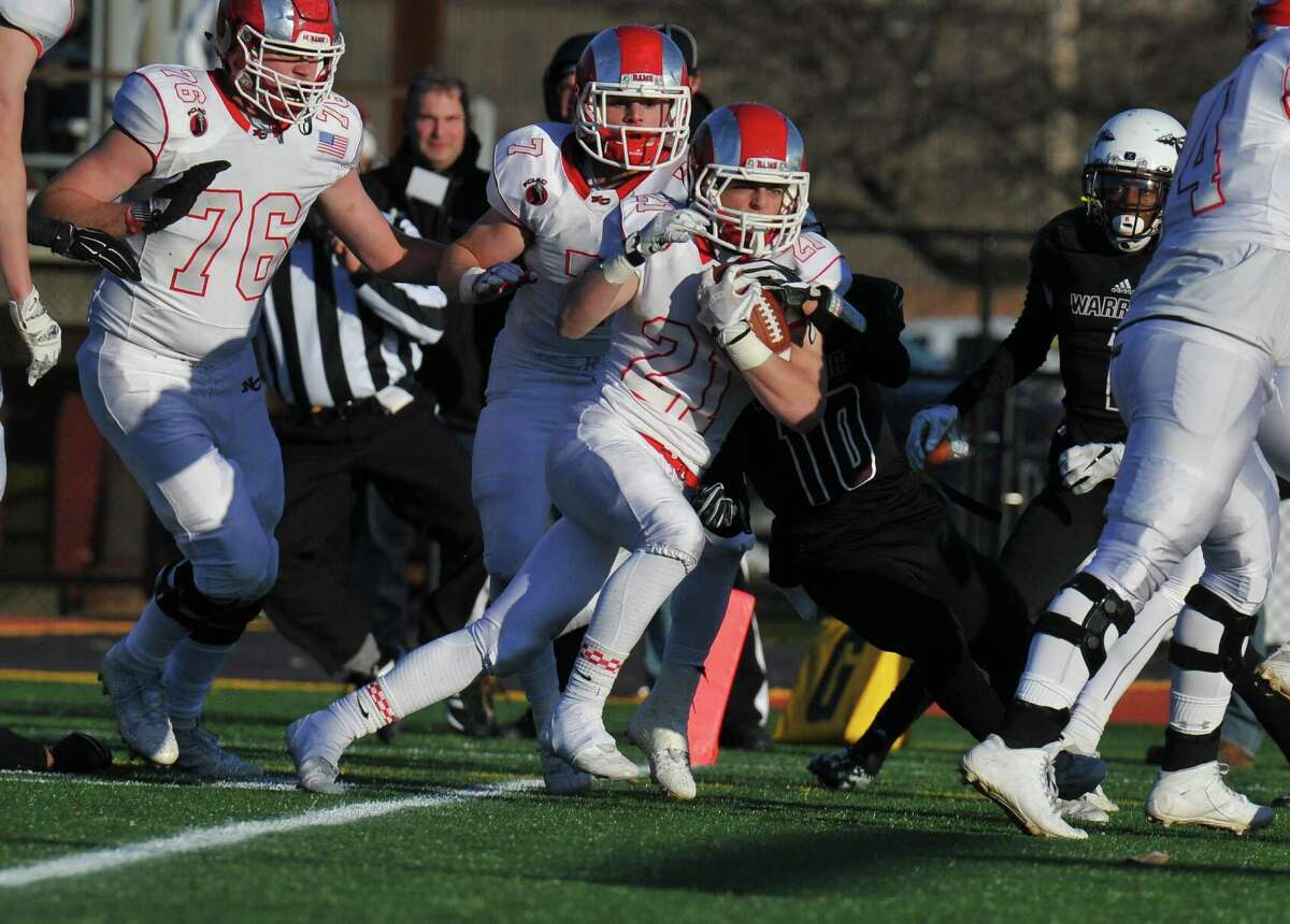 New Canaan's Graham Braden crosses the goal line for a touchdown during the Class L state championship against Windsor Saturday in New Britain.
