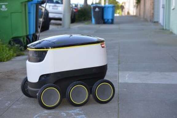 Starship Technologies' delivery robot sits parked outside on a San Francisco sidewalk, on the morning of Nov. 16, 2016. (Tori Owens/Peninsula Press)