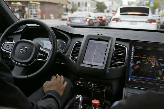In this photo taken Tuesday, Dec. 13, 2016, an Uber driverless car waits in traffic during a test drive in San Francisco. Uber is bringing a small number of self-driving cars to its ride-hailing service in San Francisco - a move likely to both excite the city�s tech-savvy population and spark a conflict with California regulators. The Wednesday, Dec. 14, launch in Uber�s hometown expands a public pilot program the company started in Pittsburgh in September. (AP Photo/Eric Risberg)