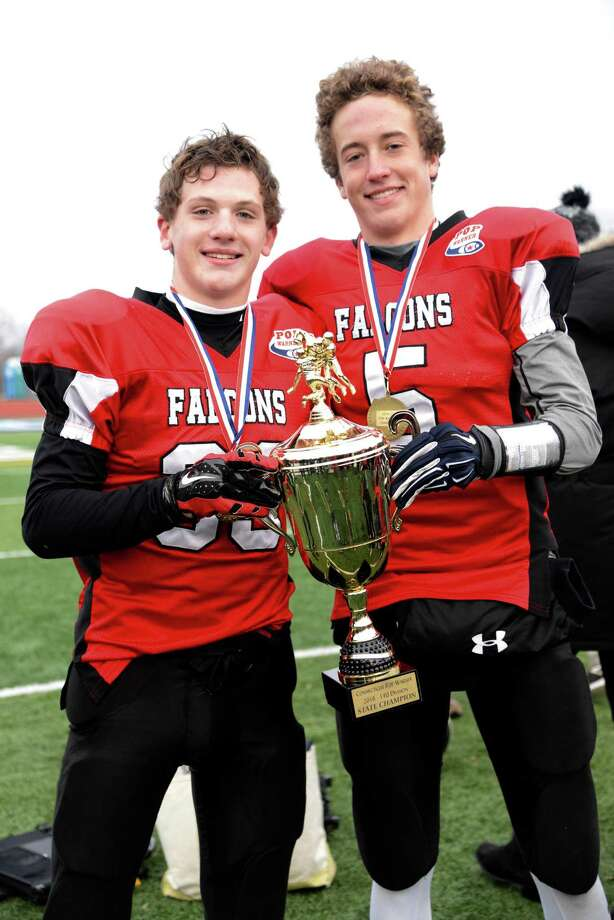 Shane Baldwin, left, and Austin Andersen, right, of the New Canaan Country School pose with the championship trophy after the New Fairfield Falcons captured the national title last weekend in Indiana. Photo: Contributed Photo / New Canaan News contributed