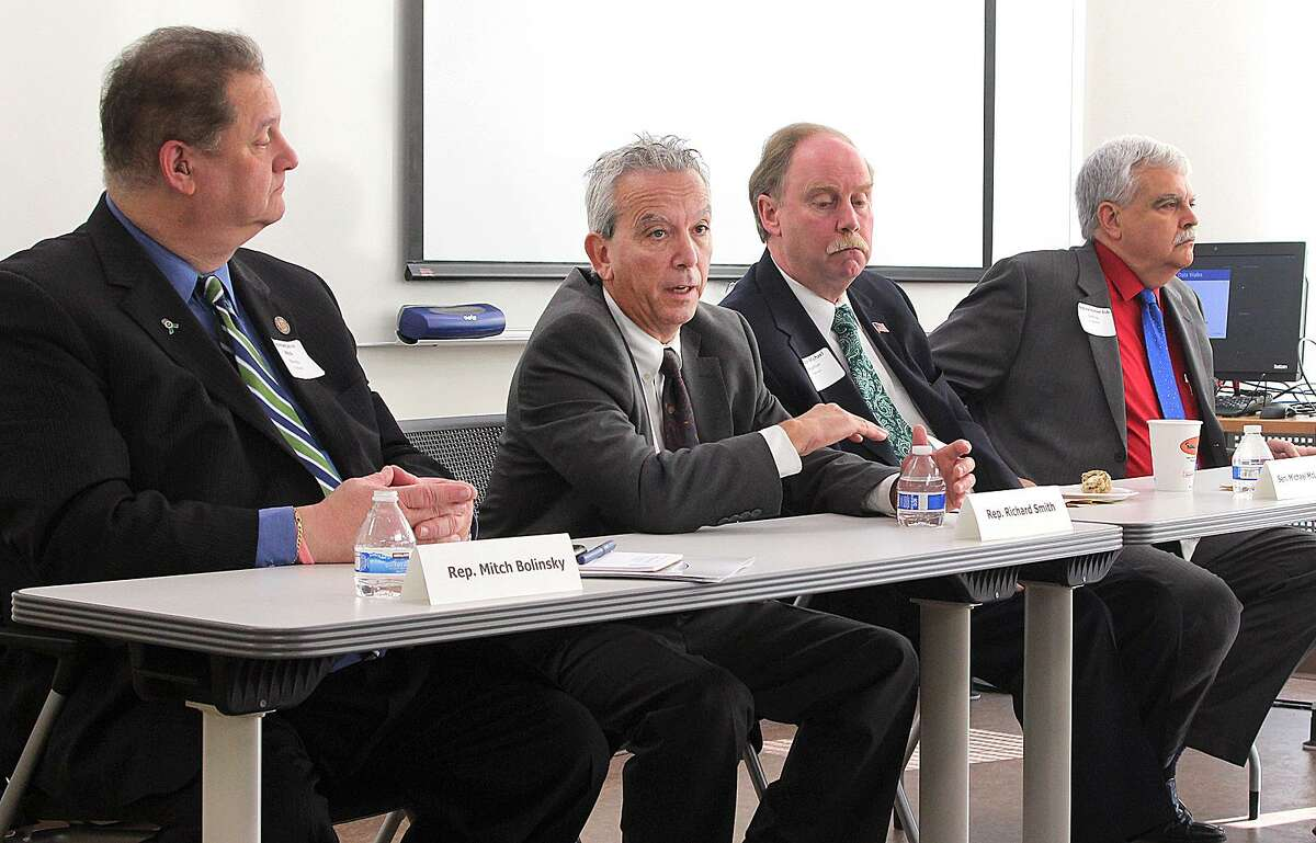 State Rep. Richard Smith, second from left, makes a point while state Rep. Mitch Bolinsky, left, state Sen. Michael McLauchlan and state Rep. Bob Godfrey listen during a panel discussion of the Fairfield County Community Wellbeing Index 2016 held Wednesday, Dec. 14, 2016, at Naugatuck Valley Community College in Danbury, Conn.