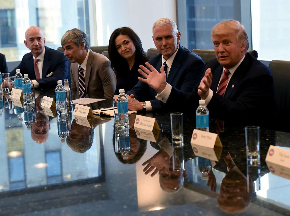 (L-R) Amazon's chief Jeff Bezos, Larry Page of Alphabet, Facebook COO Sheryl Sandberg , Vice President elect Mike Pence and President-elect Donald Trump attend a meeting at Trump Tower December 14, 2016 in New York. / AFP PHOTO / TIMOTHY A. CLARYTIMOTHY A. CLARY/AFP/Getty Images