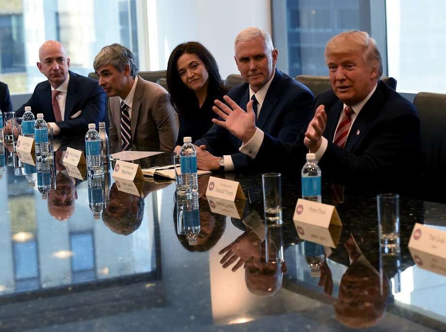 In this Dec. 14, 2016 file photo, Amazon's chief Jeff Bezos, Larry Page of Alphabet,  Facebook COO Sheryl Sandberg, Vice President elect Mike Pence and President-elect Donald Trump attend a meeting at Trump Tower December 14, 2016 in New York. Photo: TIMOTHY A. CLARY, AFP/Getty Images