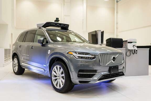 (FILES) This file photo taken on September 13, 2016 shows a pilot model of the Uber self-driving car is displayed at the Uber Advanced Technologies Center in Pittsburgh, Pennsylvania. Uber announced December 14, 2016 that it would extend its testing of autonomous vehicles to San Francisco, the second city in its ambitious autonomous ride-sharing project. The move comes three months after Uber began testing self-driving cars to move people in Pittsburgh, Pennsylvania, with four vehicles -- along with a driver and technician onboard to deal with any glitches or emergencies.  / AFP PHOTO / Angelo MerendinoANGELO MERENDINO/AFP/Getty Images