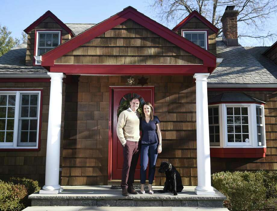 Millennial home buyers Ryan Particelli and Jennifer Bayard Particelli pose with their dog, Chevy, in front of their home on Mead Avenue in the Cos Cob section of Greenwich, Conn. Wednesday, Dec. 14, 2016. Photo: Tyler Sizemore / Hearst Connecticut Media / Greenwich Time