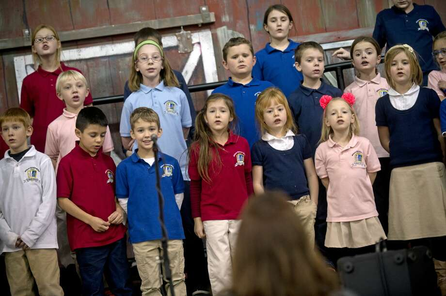 Students sing during rehearsal for the school's Christmas concert on Wednesday at Midland Christian School. The concert is Dec. 15 at 7 p.m in the gymnasium. All are welcome. Photo: Erin Kirkland/Midland Daily News