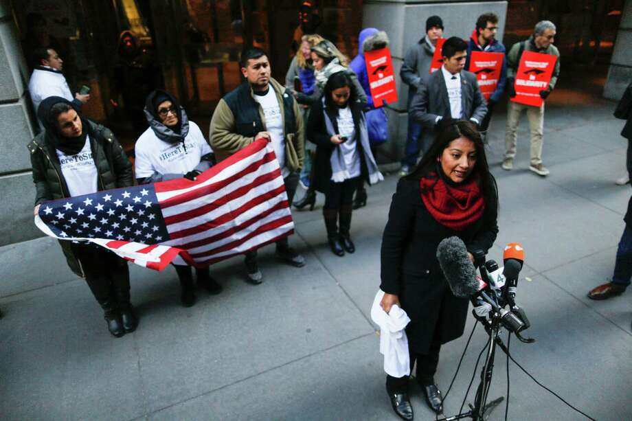 """A woman speaks as people known as """"Dreamers"""" hold a press conference to launch the """"Caravan of Courage"""" to show that the undocumented community will """"not fear Trump's presidency"""" outside a Trump building in New York. President Obama should not pardon the Dreamers. They did nothing wrong. Photo: EDUARDO MUNOZ ALVAREZ /AFP /Getty Images / AFP or licensors"""